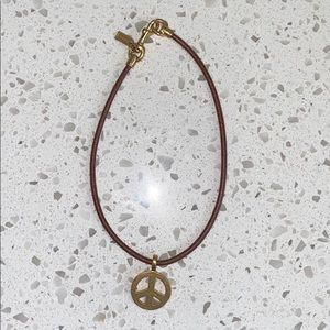 Coach peace sign leather and gold necklace